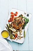 Roast chicken with tarragon and roasted vegetables