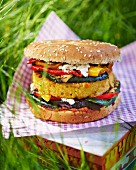 A vegetable burger at a picnic