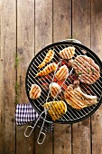 Barbecued meat and chicken skewers on the barbecue grill