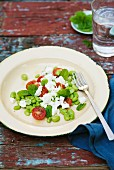 Bean salad with tomatoes, feta and mint