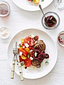 Sirloin steaks with tomato, ricotta and quick onion pickle