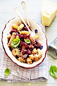 Spiral pasta with aubergines and purple carrots