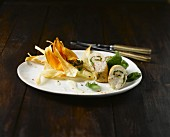 Rolled chicken with vegetable crisps