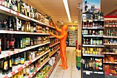 A man in an orange costume looking at products in a supermarket