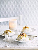 Coconut pavlovas with banana and passionfruit