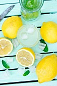 Lemonade with ice cubes and mint (view from above)