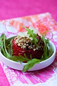 A red pepper stuffed with quinoa, with parmesan and rocket