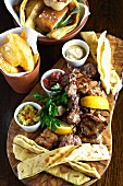 Mixed grill with dips and flatbread