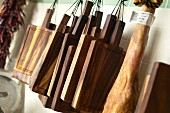 Chopping boards hanging up in a kitchen