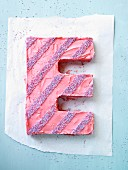 A cake in the shape of an E