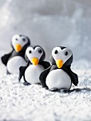 Three marzipan penguins