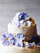 A wedding cake with sugared spring flowers