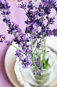 Lavender flowers in a glass of water as a table decoration