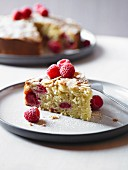 Bakewell tart with raspberries and sliced almonds