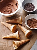 Ice cream cones, chocolate buttercream and grated chocolate for decorating a cake