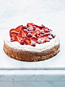 Hazelnut cake with meringue, strawberries and raspberries