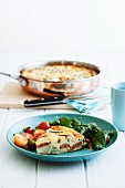 Frittata with potatoes and chorizo in a pan and on a plate