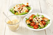 Caesar salad with tomatoes and chicken breast