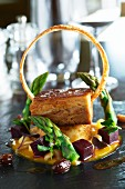 Pork belly with green asparagus and cubes of beetroot