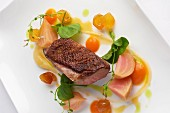 Duck breast with spring vegetables and pea shoots