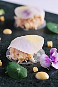 Crab salad between slices of pickled radish