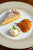 Hazelnut tart with a caramelised pear and vanilla ice cream