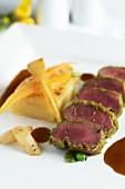 Lamb fillet with a herb crust and potato gratin