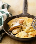 Kaiserschmarren (shredded pancake) in frying pan