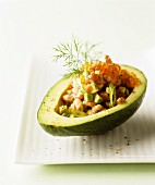 Avocado and prawn salad in a hollowed-out avocado topped with caviar