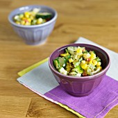 Grilled Corn Salad with Cucumbers in a Purple Bowl