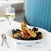 New England Fish Stew with Head on Shrimp, Mussels, Clams, Cod, Fresh Chorizo, Red Potatoes, Saffron-Tomato Shellfish Broth
