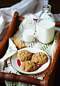 Anzac biscuits and milk on a tray (Australia)
