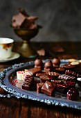 Assorted chocolates on an antique tray