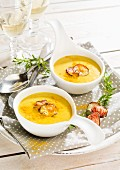 Curry & coconut soup with beetroot crisps