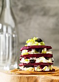 Beetroot and cream cheese tower with prunes and leek