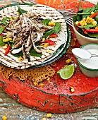 Jerk chicken and roasted corn salad tortillas