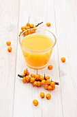 A glass of sea buckthorn juice