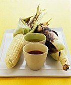 Grilled corn cobs with dips