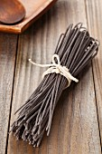 Home-made squid ink pasta, dried and tied in a bundle