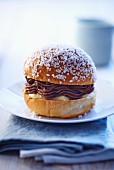 A sweet bread roll filled with chocolate and vanilla cream