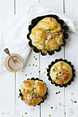 Brioches with caramel sauce and pistachios