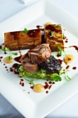 Pork medallions, crispy pork belly and pork in puff pastry
