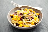 Tagliatelle with pumpkin, cranberries and parsley