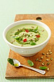 Cream of courgette soup with pesto and pumpkin seeds