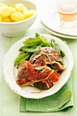 Saltimbocca with sugar snap peas and boiled potatoes