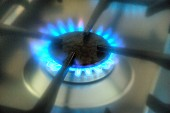 A lit ring on a gas hob (close-up)