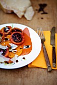 Papaya and tamarillo salad with parmesan shavings