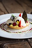 Lemon cake with whipped cream and berries