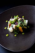 Herring salad with vegetables and pea puree