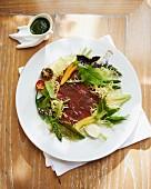 Duck carpaccio with a salad garnish